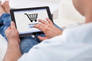 Man online shopping home