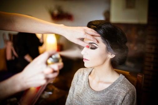 Bride getting hair makeup done