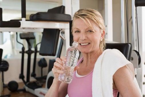 Woman water bottle towel gym