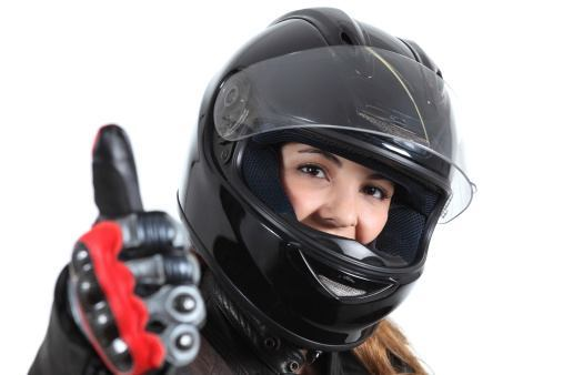 Woman wearing motorcycle gloves