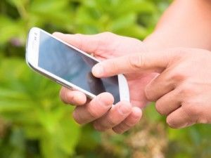 Man hand touching screen on modern mobile smart phone