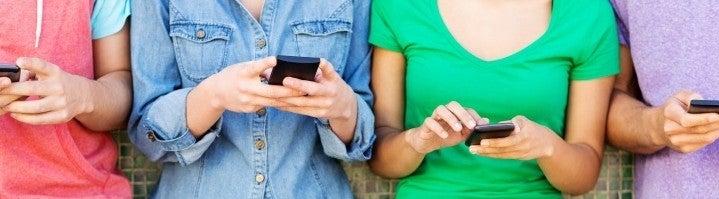teens using phones banner