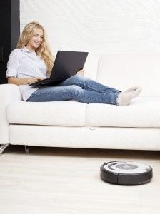 woman with robot vacuum cleaner